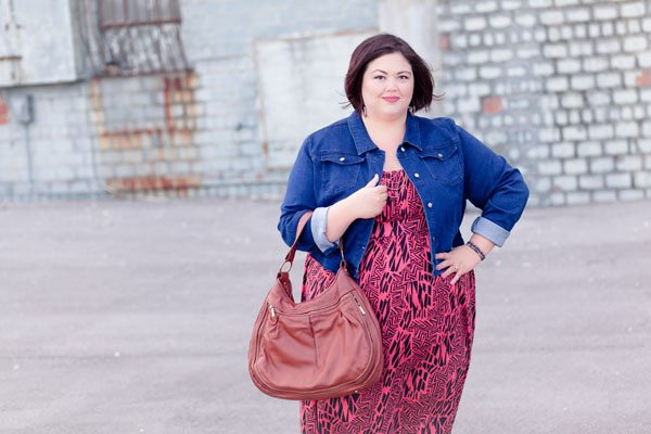 Plus size fashion blogger Authentically Emmie in a SWAK maxi dress from Gwynnie Bee and a SWAK denim jacket