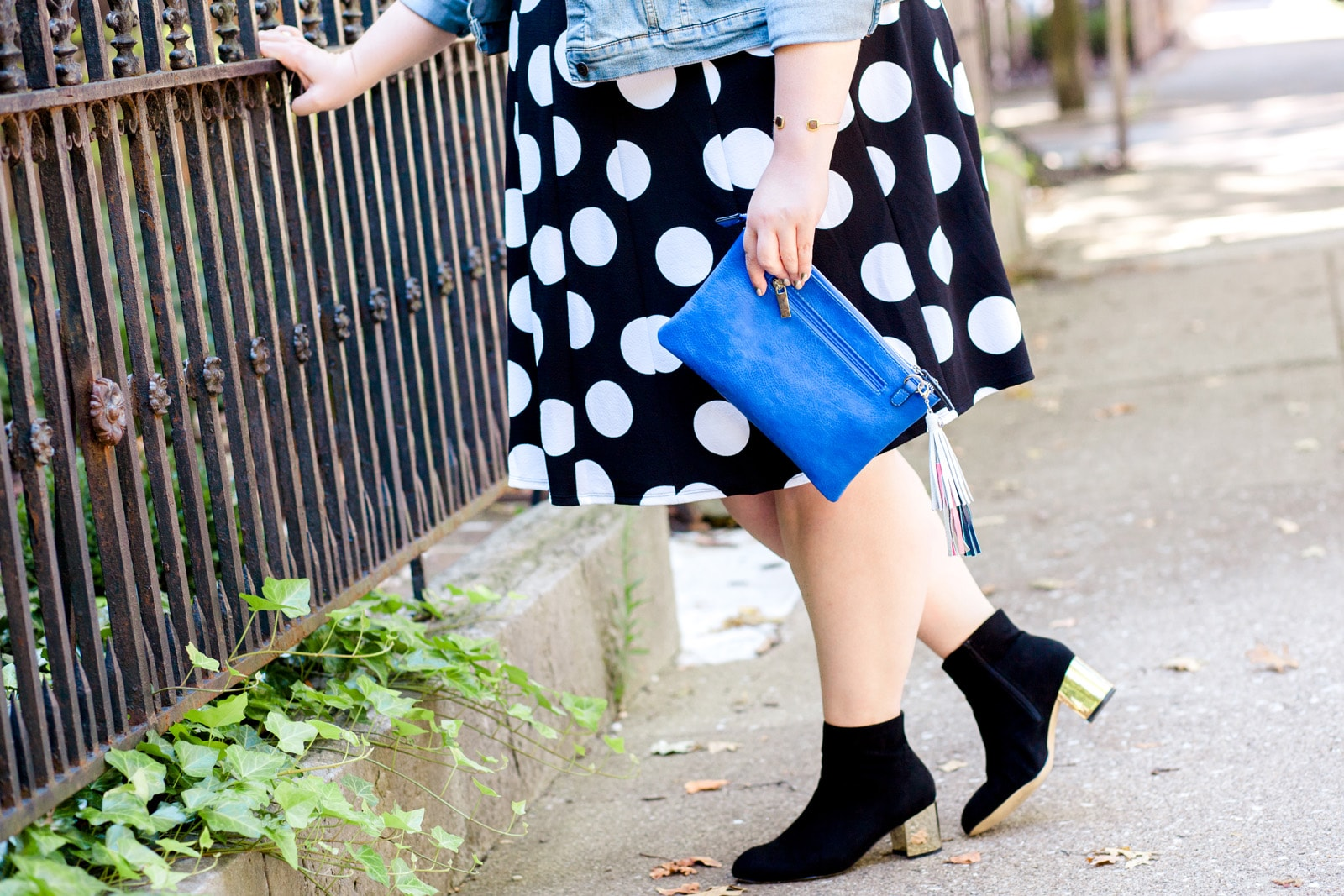 Authentically Emmie in a Gwynnie Bee dress, Eloquii boots, and Debshops clutch