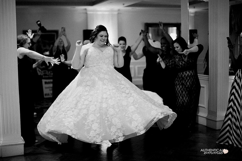 Plus size bride Authentically Emmie dances in her wedding gown