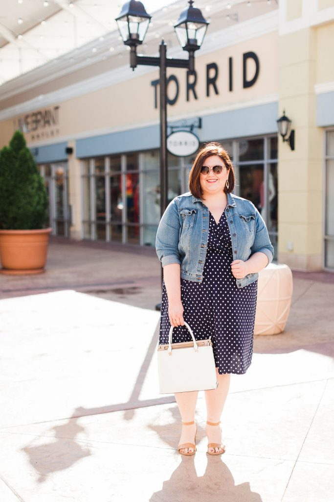 plus size fashion blogger Authentically Emmie in front of the Torrid outlet near Louisville
