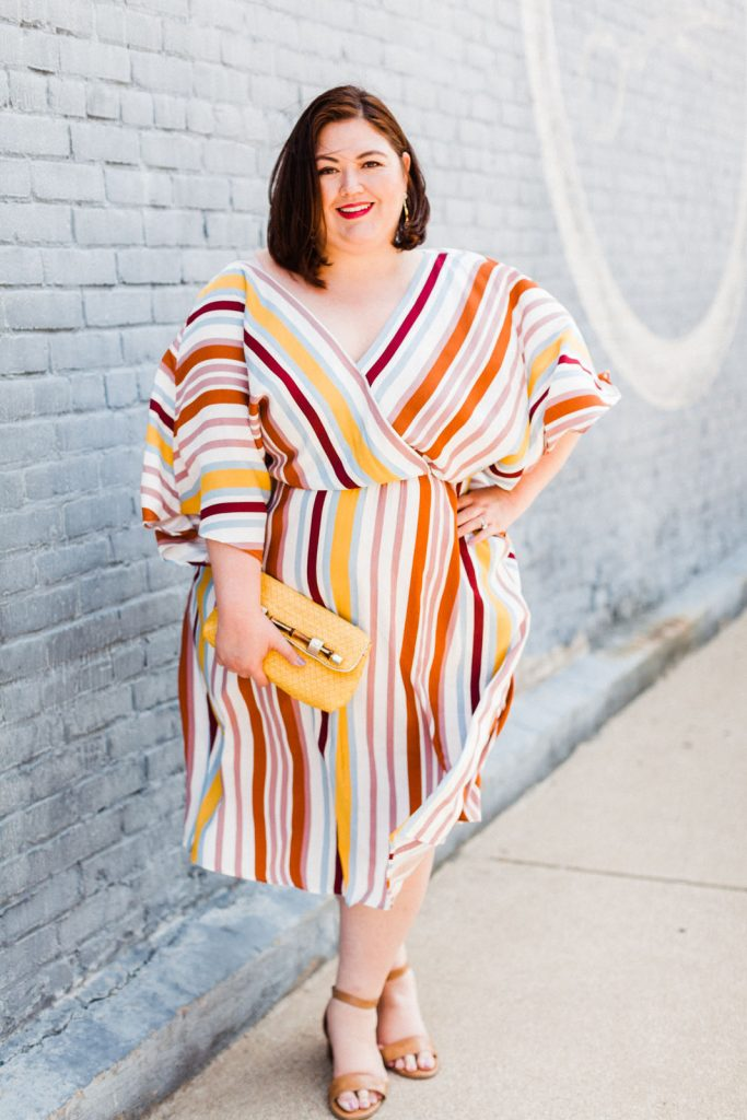 Plus size blogger Authentically Emmie in a striped dress from ELOQUII