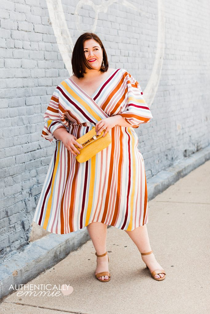 Plus size blogger Authentically Emmie in an ELOQUII striped dress