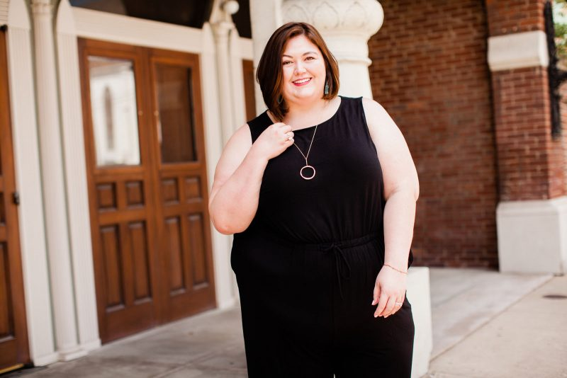 Plus size fashion blogger Authentically Emmie in a Catherines jumpsuit