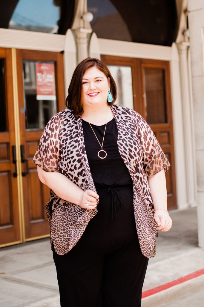 Plus size fashion blogger Authentically Emmie in a Catherines jumpsuit with leopard kimono