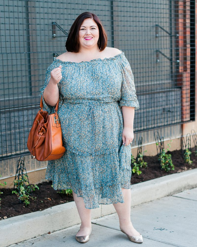Authentically Emmie, plus size blogger, in an Anthropologie off the shoulder Dress