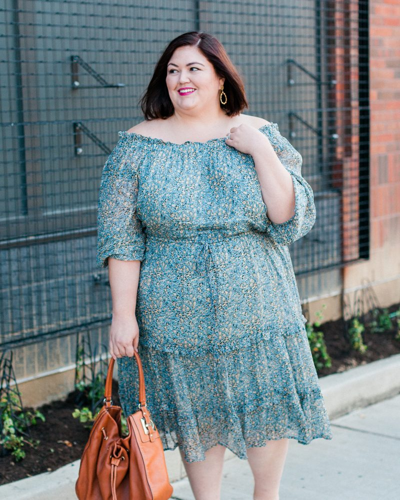Plus size fashion blogger Authentically Emmie in an Anthropologie off the shoulder Dress
