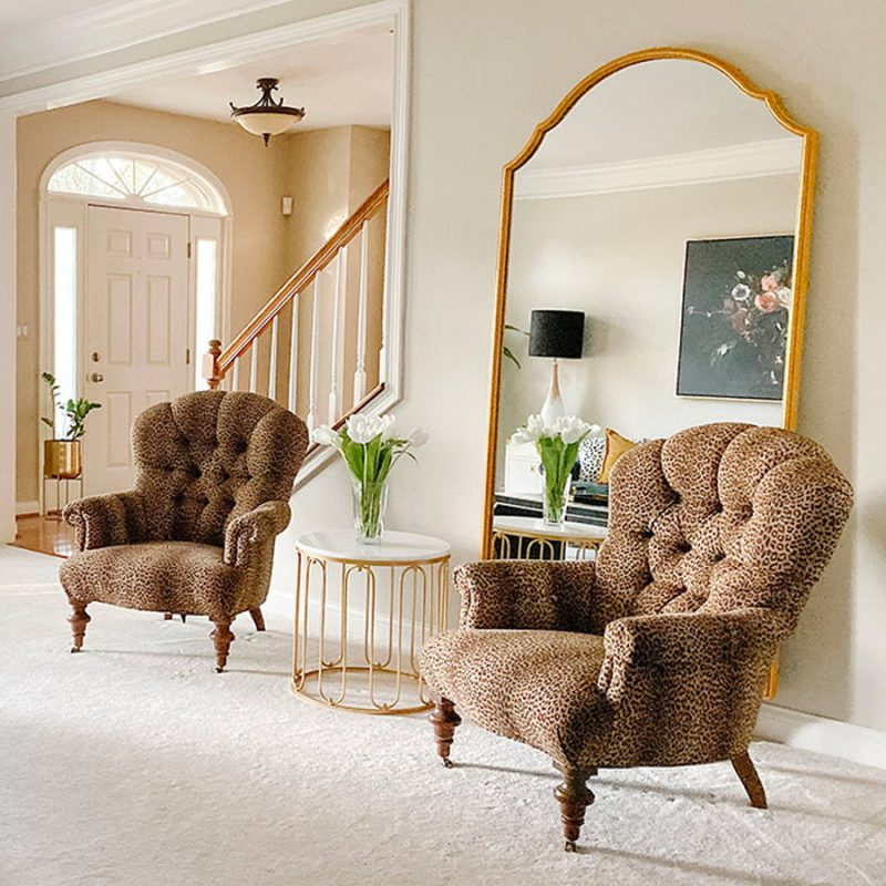 Vintage leopard print chairs and an oversized mirror from Ballard Designs