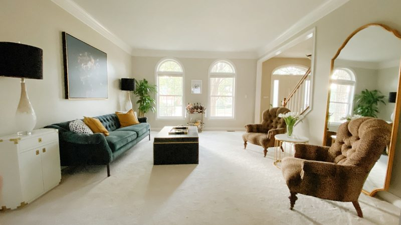 Formal living room design that mixes Hollywood Regency with transitional decor.