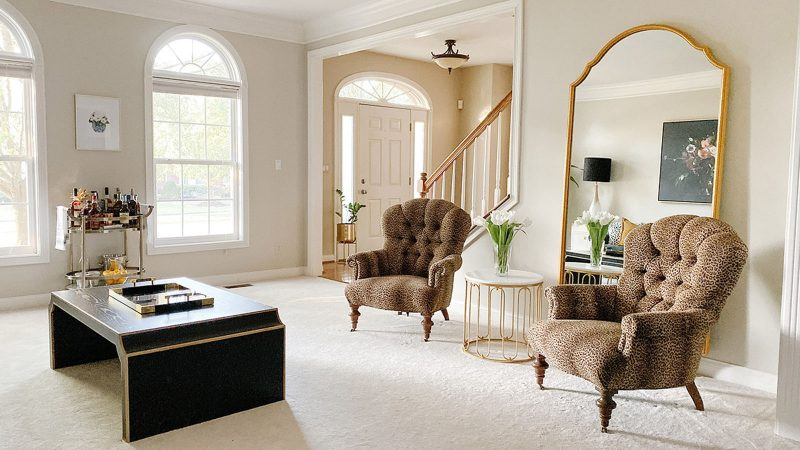 A formal living room that mixes Hollywood Regency with transitional decor.