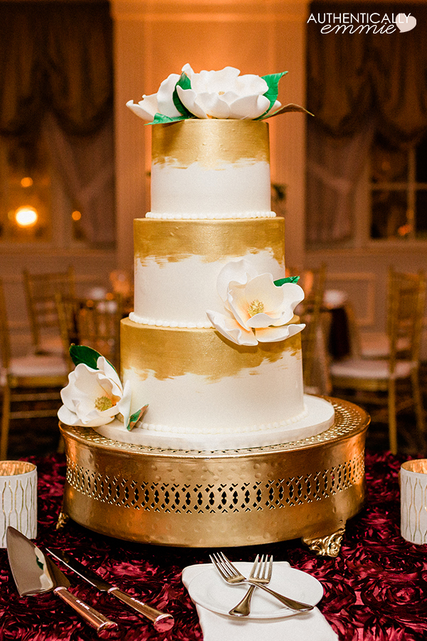 Magnolia sugar flowers on wedding cake with gold