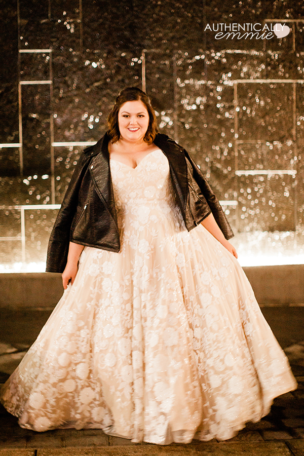 Plus size wedding gown with sequins and a leather moto jacket on blogger Authentically Emmie