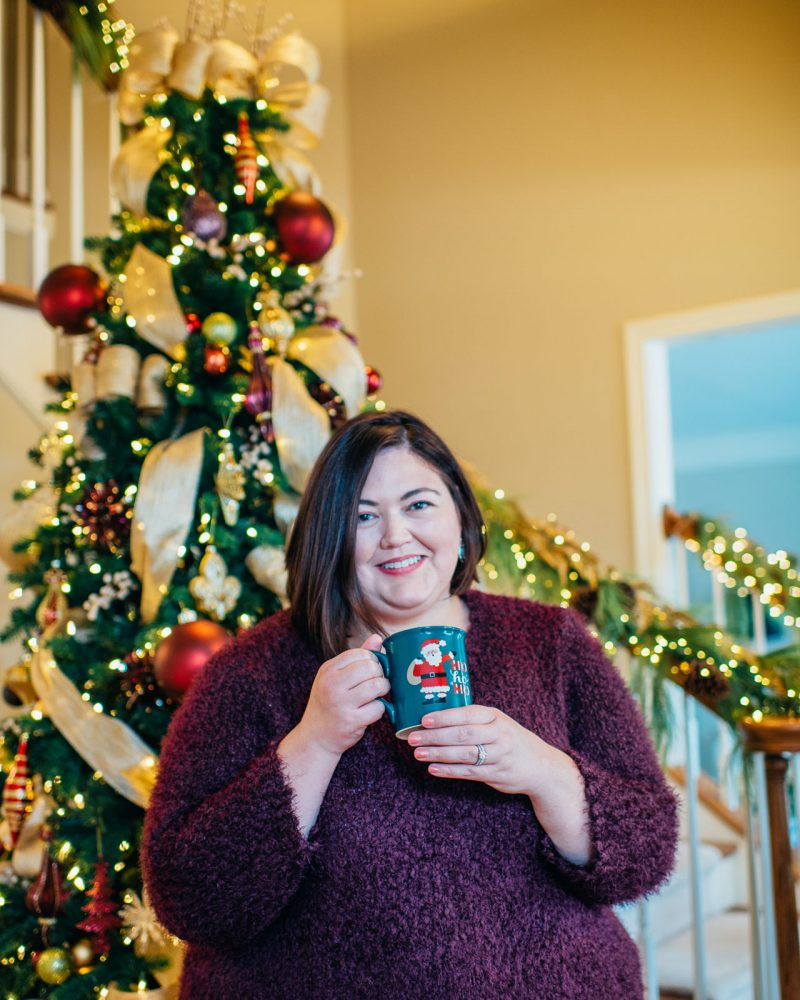 Holiday decorations and relaxing at home in an outfit from Catherines