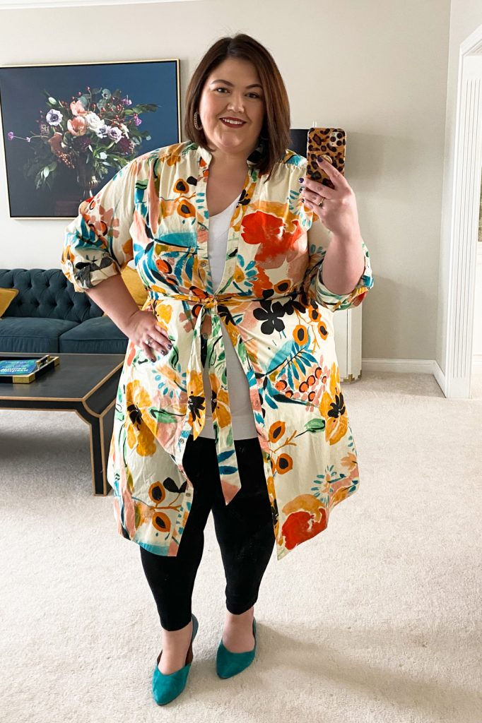 Plus size fashion blogger Authentically Emmie with an Anthropologie dress styled as a topper