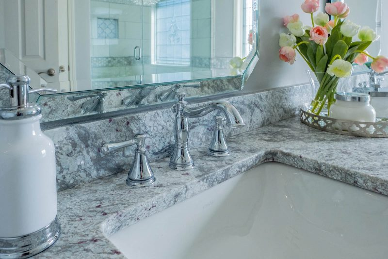 Delta chrome faucet and pretoria white granite in a master bathroom
