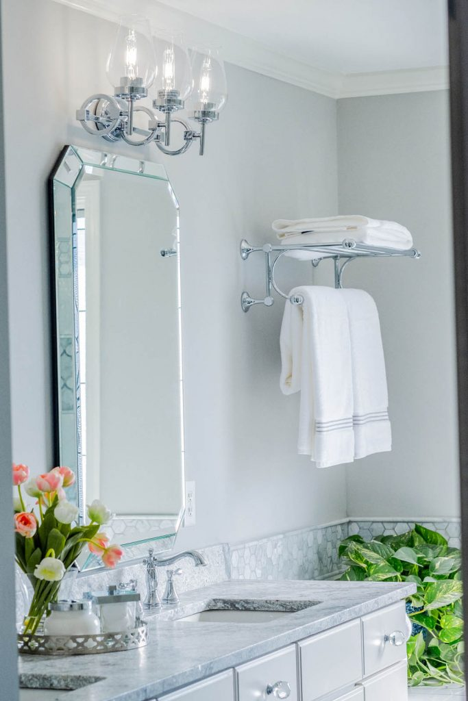 Master bathroom renovation with chrome, gray, and white finishes