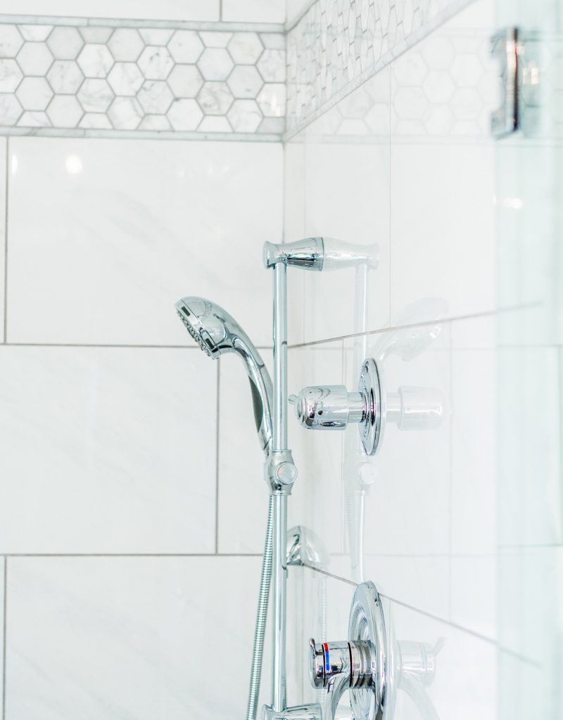 Master bathroom shower with chrome Delta fixtures