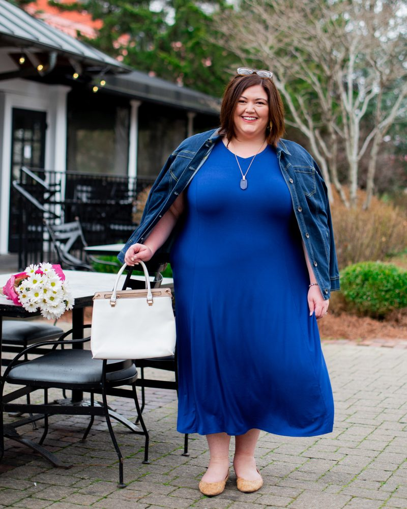 A blue maxi dress and denim jacket on plus size fashion influencer Authenticallly Emmie