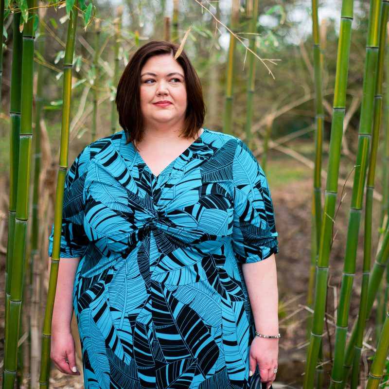 Teal and black palm print maxi dress on Louisville plus size influencer Authentically Emmie