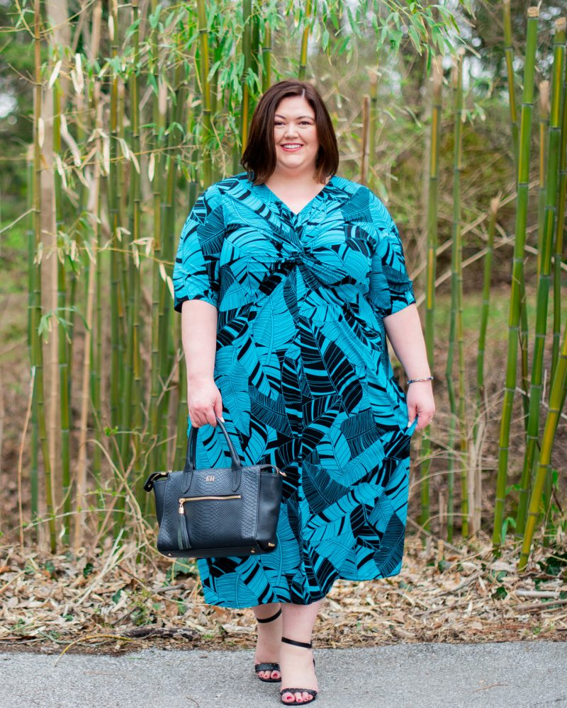 Teal and black palm print maxi dress on plus size influencer Authentically Emmie