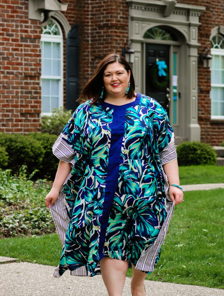 A plus size caftan with various patterns of blues on Louisville influencer Authentically Emmie