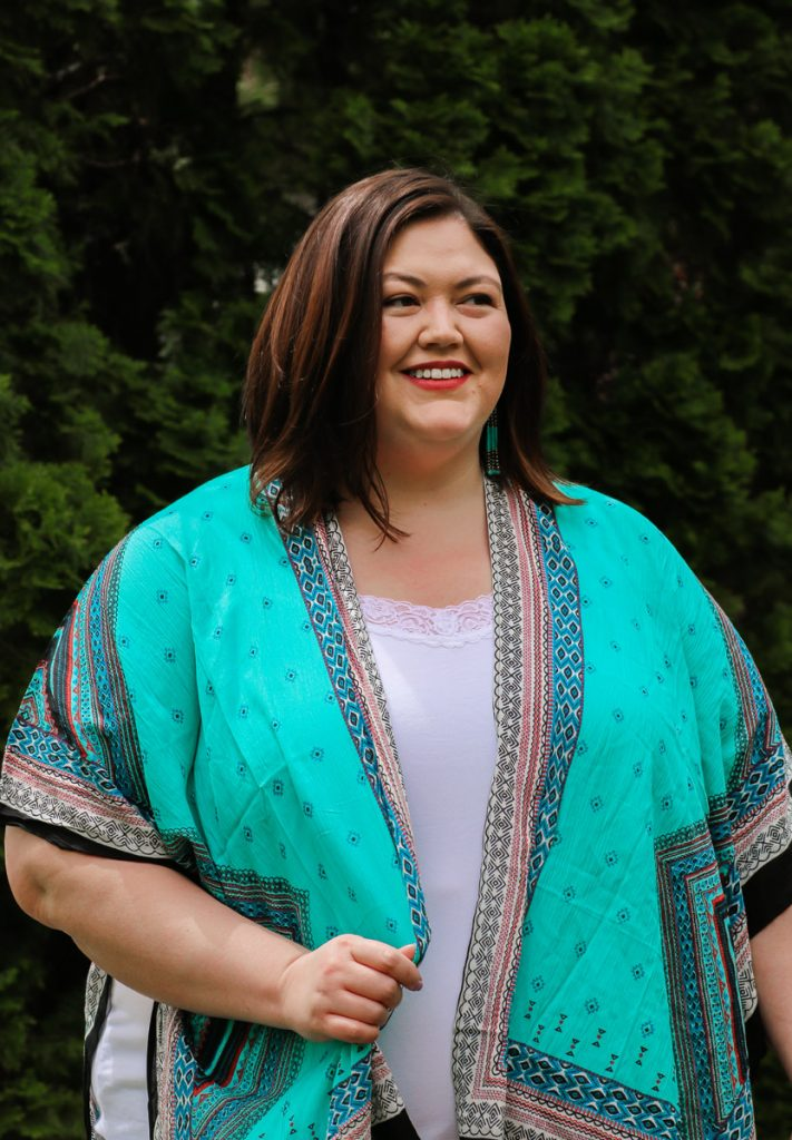 Turquoise kimono over a white tank top on plus size influencer Authentically Emmie