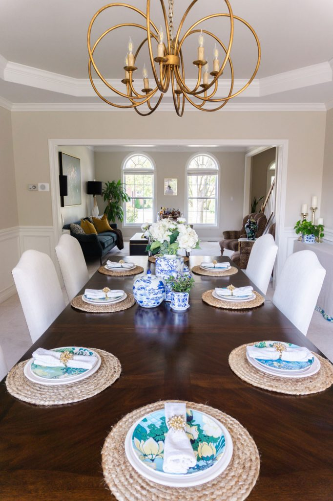 Gold Gabby chandelier and dining room place setting