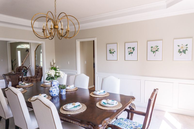 Magnolia artwork in a transitional dining room makeover