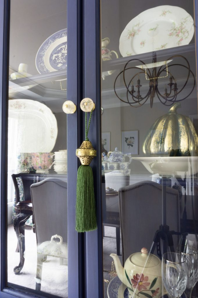 Blue china cabinet with large silk tassel