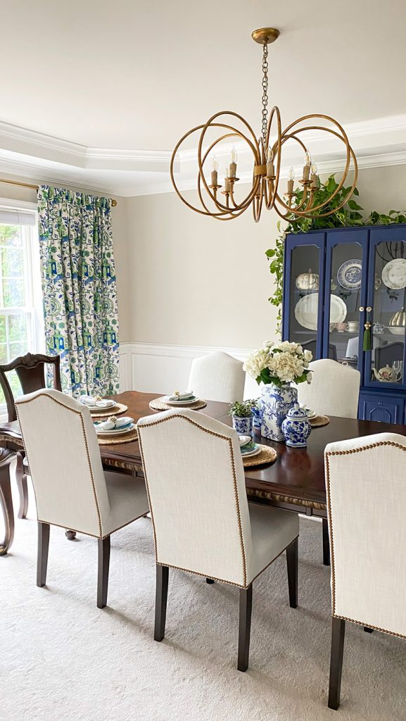 Chinoiserie inspired dining room with blue, white, and green from lifestyle blogger Authentically Emmie