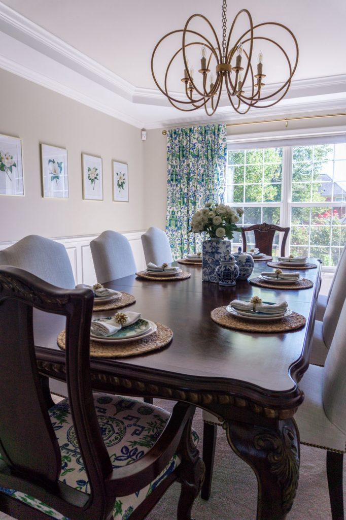 Chinoiserie dining room with gold chandelier