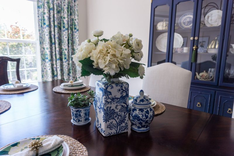 Blue and white ginger jars in a dining room.