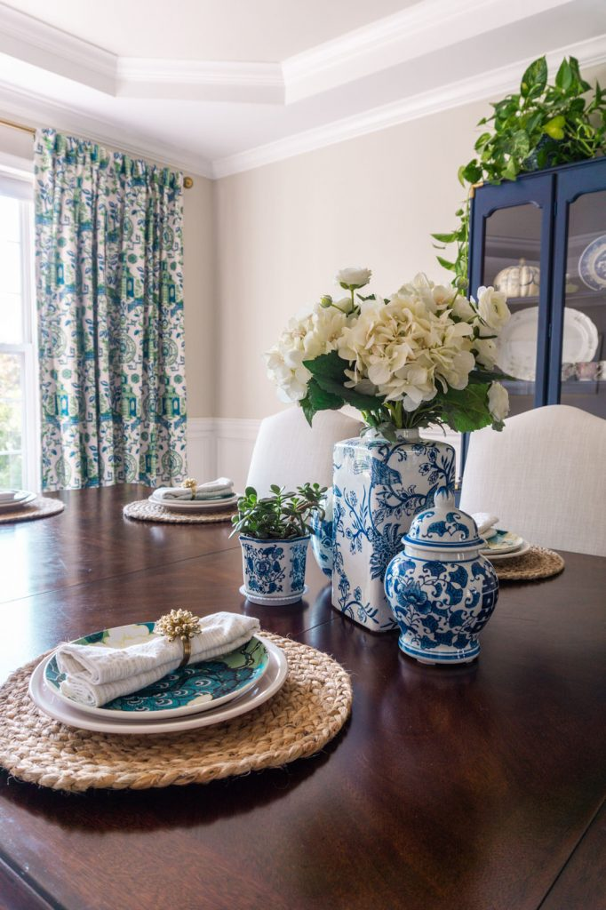 Colorful place setting in a Chinoiserie inspired dining room with blue and green