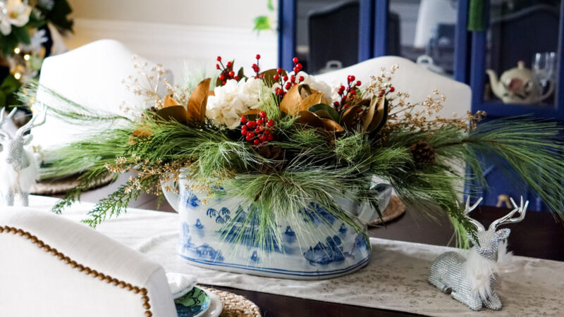 Christmas centerpiece of greens, golds, and reds in a chinoiserie inspired footbath
