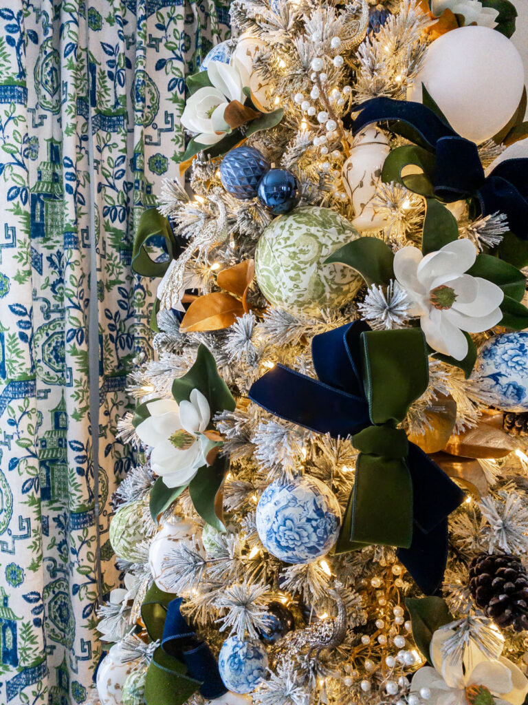 Detail of Chinoiserie Christmas tree with green, white, blue, and magnolia accents