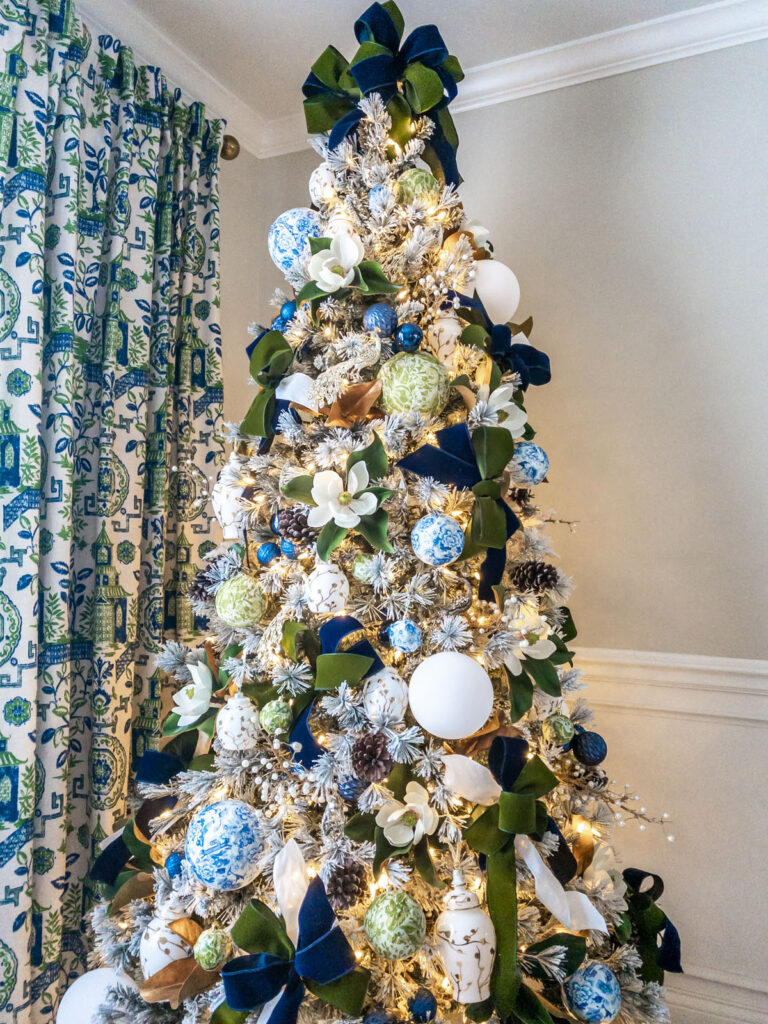 Chinoiserie Christmas tree with green, white, blue, and magnolia accents