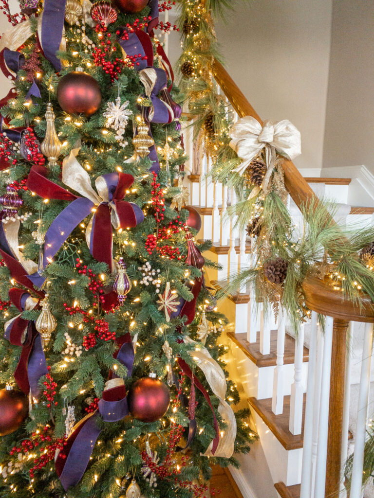 traditional Christmas tree with burgundy and purple and gold