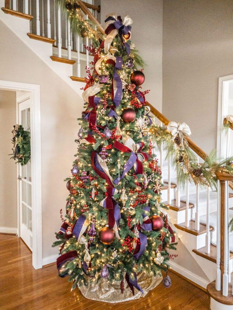 traditional Christmas tree with burgundy and purple